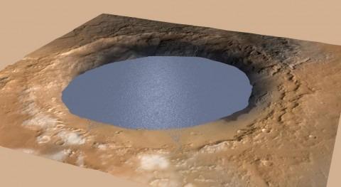 Esta ilustración representa a un lago de agua que llena parcialmente el Cráter Gale (NASA).